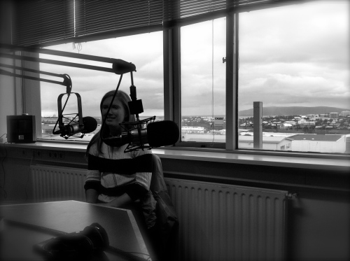 My wife, sitting in the Lindin radio studio with Reykjavik in the background.