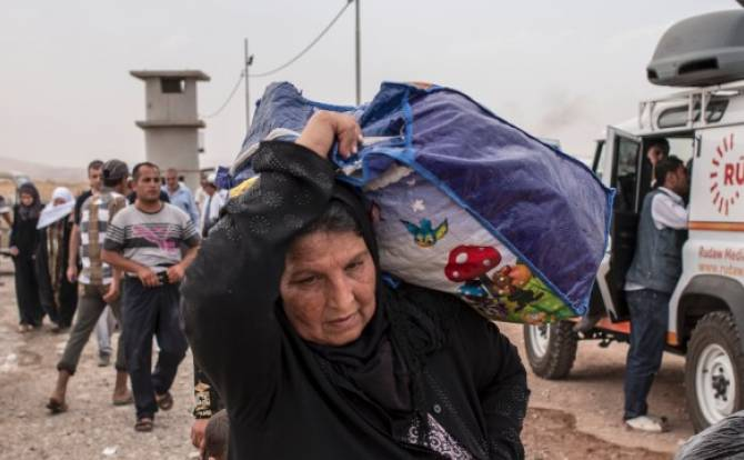 Christians among the 500,000 fleeing Mosul after ISIS took control of the city. Photo from Catholic News Service