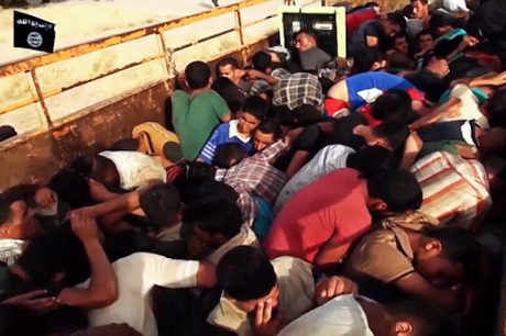 Taken from an IS video, this photo shows Iraqi prisoners, including what appear to be children, piled onto trucks before being driven off for execution. Photo from Anglican Communion News Service